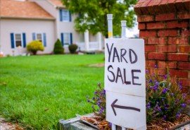 Closeup image of a yard sale sign