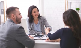 positive-insurance-broker-handshaking-with-young-WD3RUKE