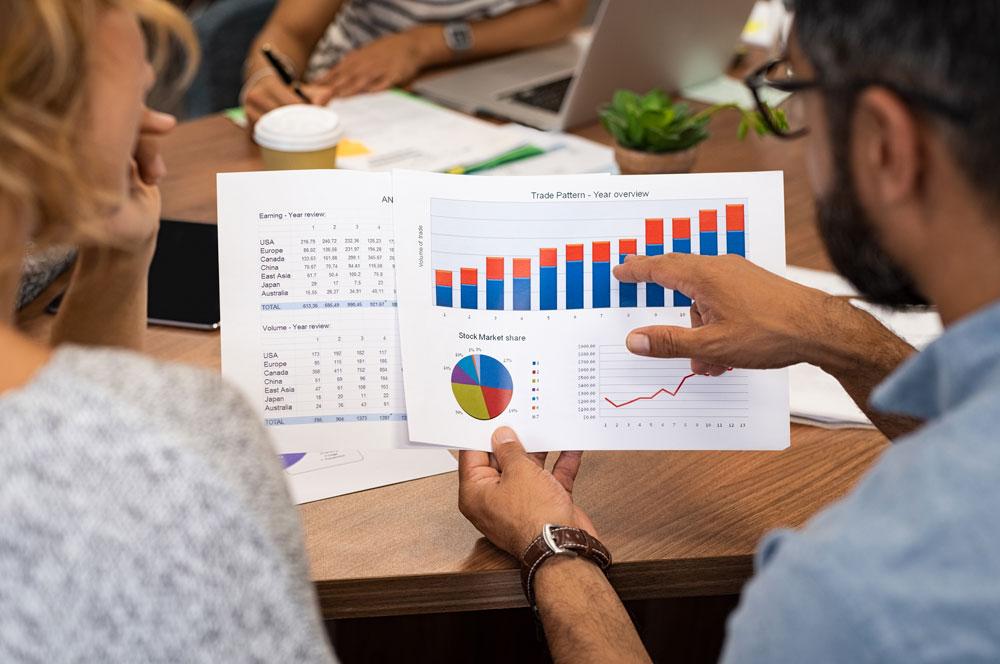 business-people-analyzing-graphs-YBKDRCN