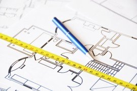Pen and ruler on a floor plan